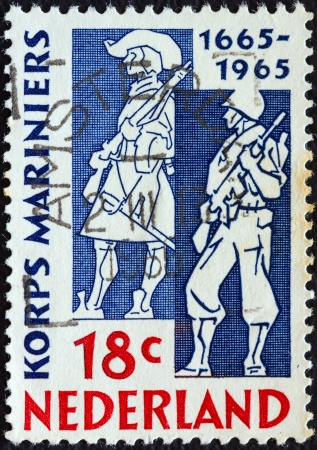 NETHERLANDS - CIRCA 1965: A stamp printed in the Netherlands issued for the tercentenary of Marine Corps shows Marines of 1665 and 1965, circa 1965.  Stock Photo - 15944495