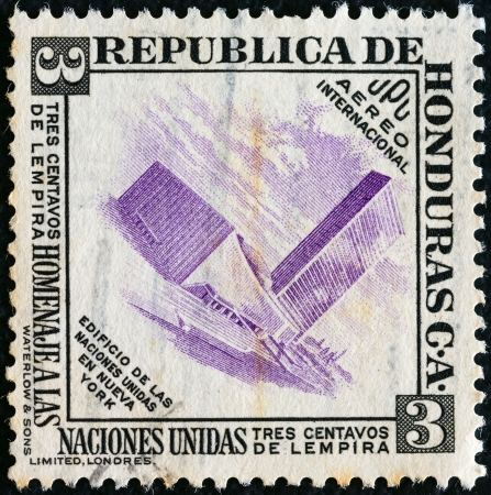 HONDURAS - CIRCA 1953: A stamp printed in Honduras issued to honor the United Nations shows U.N. building, New York, circa 1953.