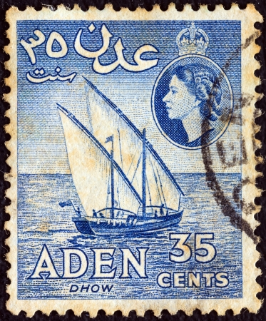 aden: ADEN COLONY - CIRCA 1953: A stamp printed in United Kingdom shows a dhow and Queen Elizabeth II, circa 1953.