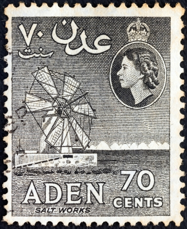 aden: ADEN COLONY - CIRCA 1953: A stamp printed in United Kingdom shows Salt Works and Queen Elizabeth II, circa 1953.