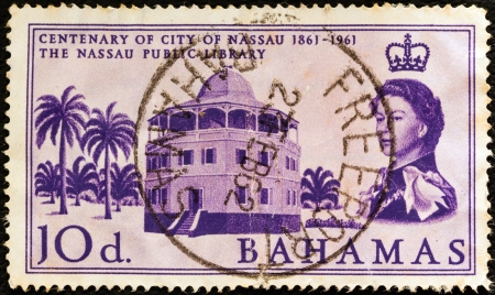 BAHAMAS - CIRCA 1961: A stamp printed in the Bahamas issued for the centenary of city of Nassau shows Nassau Public Library and Queen Elizabeth II, circa 1961.