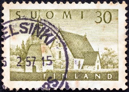 suomi: FINLAND - CIRCA 1956: A stamp printed in Finland shows Lammi Church, circa 1956.  Editorial