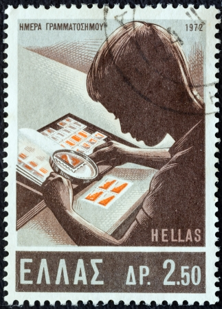 GREECE - CIRCA 1972: A stamp printed in Greece from the Stamp Day issue shows a young stamp collector, circa 1972.