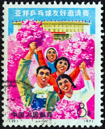 warm welcome: CHINA - CIRCA 1971: A stamp printed in China from the Afro-Asian Table Tennis Friendship Invitational tournament issue shows the warm welcome of the Afro-Asian friends, circa 1971.  Editorial