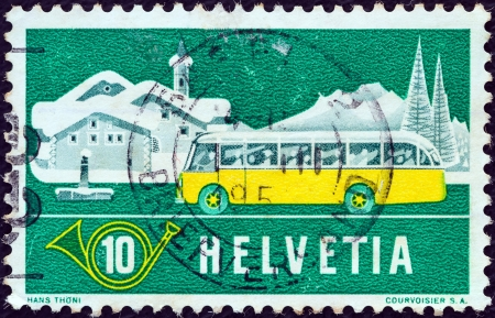posthorn: SWITZERLAND - CIRCA 1953: A stamp printed in Switzerland shows Mail Alpine Postal Coach and Winter Landscape, circa 1953.