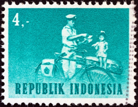 INDONESIA - CIRCA 1964: A stamp printed in Indonesia shows mailman with bicycle, circa 1964.  Stock Photo - 16232790
