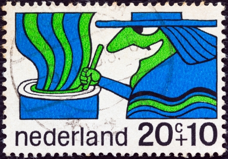 stempeln: NETHERLANDS - CIRCA 1968: A stamp printed in the Netherlands from the Child Welfare issue shows a Witch, circa 1968.