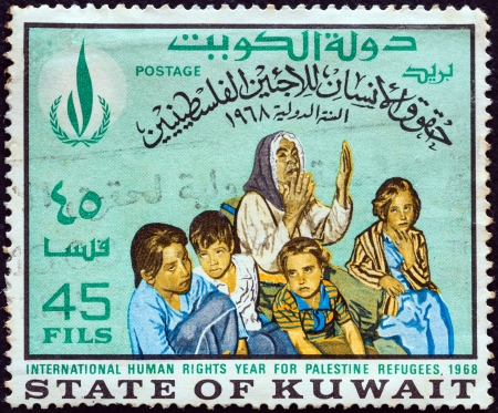 KUWAIT - CIRCA 1968: A stamp printed in Kuwait from the International Human Rights Year issue shows Palestine Refugees, circa 1968.