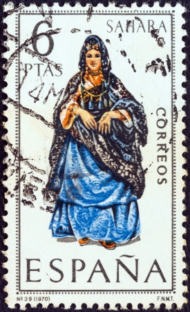 SPAIN - CIRCA 1970: A stamp printed in Spain from the Provincial Costumes issue shows a woman from Sahara, circa 1970.