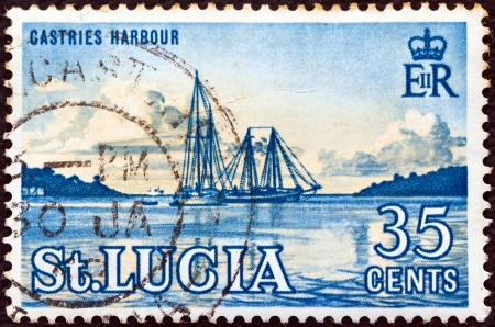 st lucia: SAINT LUCIA - CIRCA 1964: A stamp printed in Saint Lucia shows Castries Harbour, circa 1964.  Editorial
