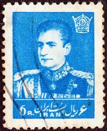 mohammad: IRAN - CIRCA 1958: A stamp printed in Iran shows Mohammad Reza Pahlavi, circa 1958.  Editorial