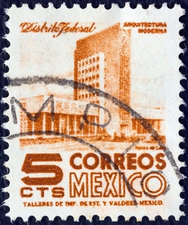 MEXICO - CIRCA 1950: A stamp printed in Mexico shows modern building, Mexico City, circa 1950.  Stock Photo - 16377703