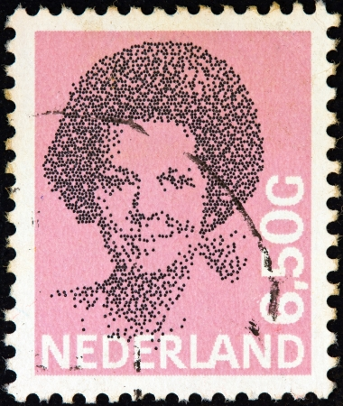 NETHERLANDS - CIRCA 1981: A stamp printed in the Netherlands shows a portrait of Queen Beatrix, circa 1981.  Stock Photo - 16532362