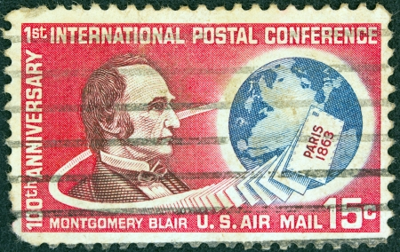postmaster: USA - CIRCA 1963: A stamp printed in USA issued for the Centenary of Paris Postal Conference shows a portrait of Montgomery Blair, Letters and Globe, circa 1963.