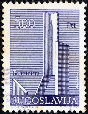 former yugoslavia: YUGOSLAVIA - CIRCA 1974: A stamp printed in Yugoslavia from the Monuments issue shows Memorial monument at Belcista village, FYROM, circa 1974. Editorial
