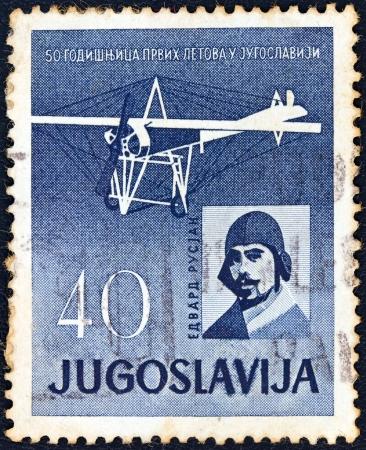 yugoslavia: YUGOSLAVIA - CIRCA 1960: A stamp printed in Yugoslavia issued for the 50th anniversary of 1st flight in Yugoslavia shows Edvard Rusjan and his airplane, circa 1960.