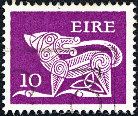 IRELAND - CIRCA 1971: A stamp printed in Ireland shows a dog from an ancient artwork, circa 1971.