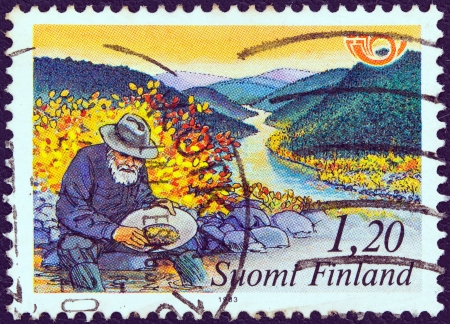 prospector: FINLAND - CIRCA 1983: A stamp printed in Finland from the Nordic countries postal co-operation. Visit the north issue shows a gold prospector, circa 1983.