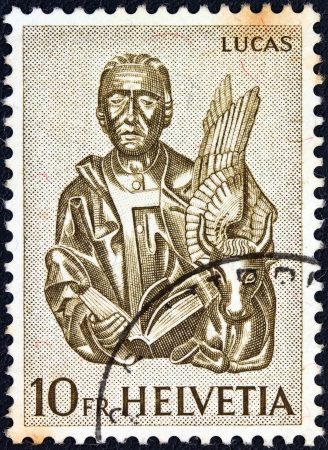 helvetia: SWITZERLAND - CIRCA 1961: A stamp printed in Switzerland from the Wood Carvings from St. Oswald Editorial
