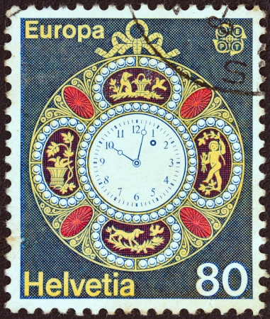 helvetica: SWITZERLAND - CIRCA 1976: A stamp printed in Switzerland from the Europa issue shows a decorated pocket watch from 1890, circa 1976.