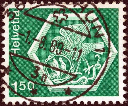 helvetia: SWITZERLAND - CIRCA 1973: A stamp printed in Switzerland from the Architecture and handicrafts issue shows a medallion from Saint Georgen Monastery, Stein am Rhein, circa 1973.