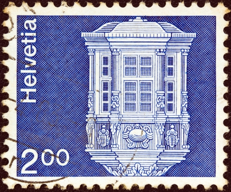 confederation: SWITZERLAND - CIRCA 1973: A stamp printed in Switzerland from the Architecture and handicrafts issue shows a detail from Saint Jean Baptiste Church, Grandson, circa 1973.