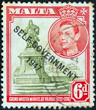 overprint: MALTA - CIRCA 1948: A stamp printed in Malta shows statue of Manoel de Vilhena and King George VI (Self-government 1947 overprint), circa 1948.