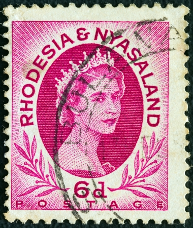 RHODESIA AND NYASALAND - CIRCA 1954: A stamp printed in Rhodesia shows Queen Elizabeth II, circa 1954.