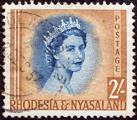 protectorate: RHODESIA AND NYASALAND - CIRCA 1954: A stamp printed in Rhodesia shows Queen Elizabeth II, circa 1954.