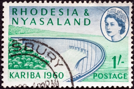 RHODESIA AND NYASALAND - CIRCA 1960: A stamp printed in Rhodesia from the Opening of Kariba Hydroelectric Scheme issue shows Barrage wall and Queen Elizabeth II, circa 1960.