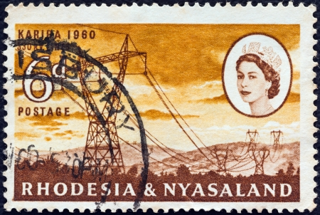 queen elizabeth ii: RHODESIA AND NYASALAND - CIRCA 1960: A stamp printed in Rhodesia from the Opening of Kariba Hydroelectric Scheme issue shows 330 kV power lines and Queen Elizabeth II, circa 1960.