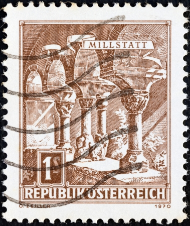 spittal: AUSTRIA - CIRCA 1970: A stamp printed in Austria from the Buildings issue shows Millstatt, circa 1970.