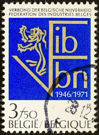 fib: BELGIUM - CIRCA 1971: A stamp printed in Belgium issued for the 25th anniversary of Federation of Belgian Industries shows F.I.B.V.B.N. emblem, circa 1971.
