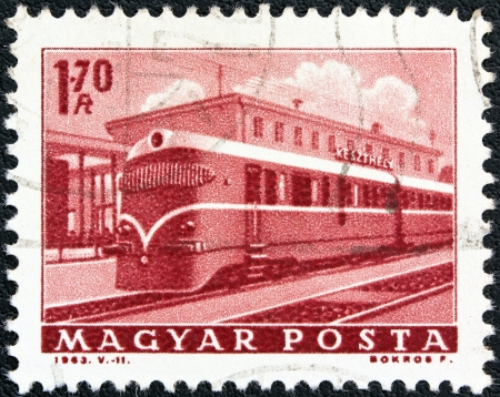 magyar posta: HUNGARY - CIRCA 1963: A stamp printed in Hungary from the Transport and Communications issue shows a Diesel-electric multiple unit train, circa 1963.