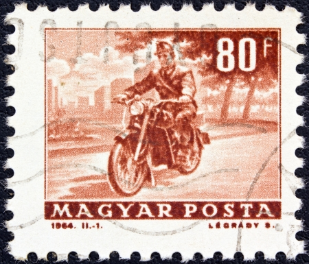 HUNGARY - CIRCA 1963: A stamp printed in Hungary from the Transport and Communications issue shows a Motorcyclist, circa 1963.