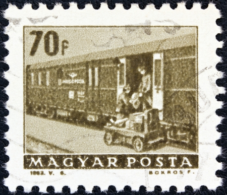 magyar posta: HUNGARY - CIRCA 1963: A stamp printed in Hungary from the Transport and Communications issue shows a Railway T.P.O. coach, circa 1963.