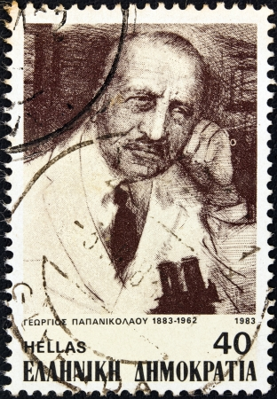 pap: GREECE - CIRCA 1983: A stamp printed in Greece from the Personalities  issue shows medical researcher Georgios Papanikolaou, circa 1983.  Editorial