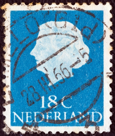 nederlan: NETHERLANDS - CIRCA 1953: A stamp printed in the Netherlands shows Queen Juliana, circa 1953.  Editorial
