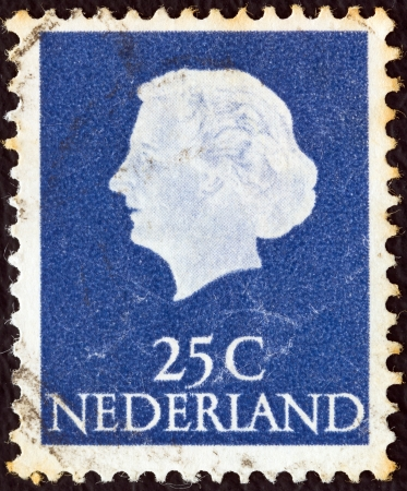 NETHERLANDS - CIRCA 1953: A stamp printed in the Netherlands shows Queen Juliana, circa 1953.  Stock Photo - 16994057