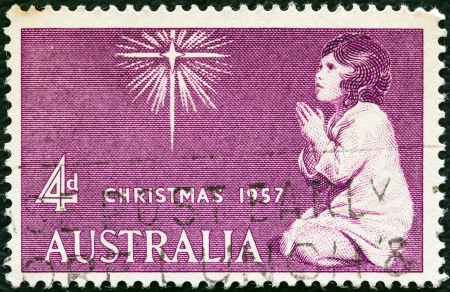 reynolds: AUSTRALIA - CIRCA 1957: A stamp printed in Australia from the Christmas issue shows The Spirit of Christmas (after Sir Joshua Reynolds), circa 1957.