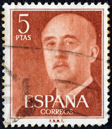SPAIN - CIRCA 1955: A stamp printed in Spain shows a portrait of Francisco Franco, circa 1955.  Stock Photo - 16994084