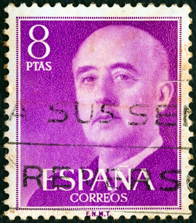 SPAIN - CIRCA 1955: A stamp printed in Spain shows a portrait of Francisco Franco, circa 1955.  Stock Photo - 16994073