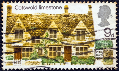 cotswold: UNITED KINGDOM - CIRCA 1970: A postage stamp printed in United Kingdom from the British Rural Architecture issue shows Cotswold limestone, circa 1970.  Editorial