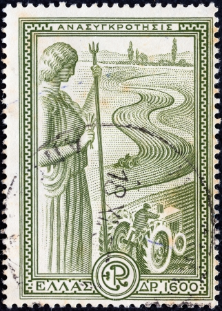 GREECE - CIRCA 1951: A stamp printed in Greece from the Reconstruction issue shows ancient goddess Demeter and tractors, circa 1951.