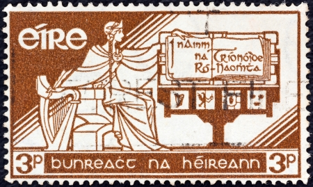 IRELAND - CIRCA 1958: A stamp printed in Ireland issued for the 21st anniversary of Irish Constitution shows Ireland and new Constitution, circa 1958.  Stock Photo - 17063048