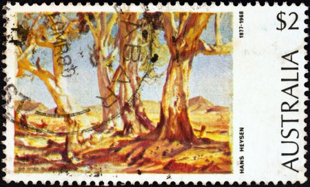 estampilla: AUSTRALIA - CIRCA 1974: A stamp printed in Australia from the Australian Paintings issue shows Red Gums of the Far North (1930) Hans Heysen, circa 1974.
