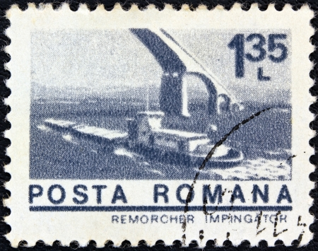 stempeln: ROMANIA - CIRCA 1974: A stamp printed in Romania from the ships issue shows Danube Tug Impingator, circa 1974.