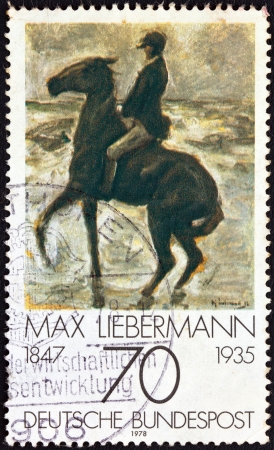 stempeln: GERMANY - CIRCA 1978: A stamp printed in Germany from the Impressionist Paintings issue shows Horseman on the shore turning left by Max Liebermann (1847-1935), circa 1978.