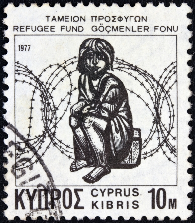 kibris: CYPRUS - CIRCA 1977: A stamp printed in Cyprus from the Refugee Fund issue shows a child in front of barbed wire (wood engraving by A. Tassos), circa 1977.  Editorial