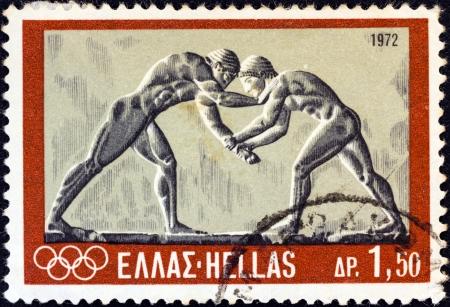 """antigua grecia: GRECIA - CIRCA 1972: Un sello impreso en Grecia desde los """"Juegos Olímpicos de Munich"""" cuestión muestra luchadores antiguos (bajorrelieve), alrededor del año 1972."""